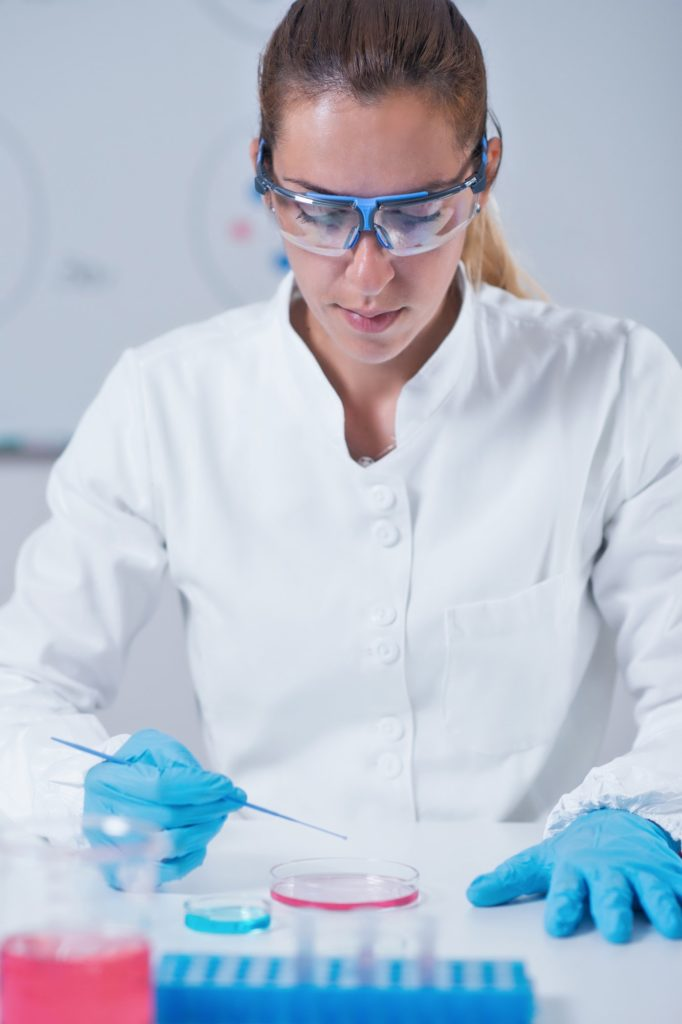 Female science researcher working in laboratory